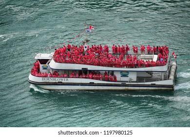 Niagara Falls, USA – August 29, 2018: Canadian ferry with tourists of the boat in tour Horseshoe waterfall Niagara Falls