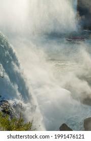 Niagara Falls, USA - October 19, 2019: Boat with tourists on a tour at the base of Horseshoe Falls, a part of Niagara Falls