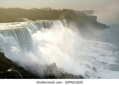 Niagara falls or Waterfalls during sunrise from Buffalo city, USA.  Here is three waterfalls located at international border between Canada and the United States