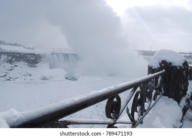 Niagara Falls in the winter with icicles, Snow, Freezing, Canada and America Border, Beautiful Landscape, Tourism Attraction, People Come and Watch the falls, January 2018