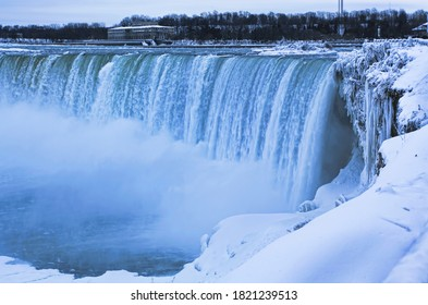 Niagara Falls in winter surrounded by snow and ice.