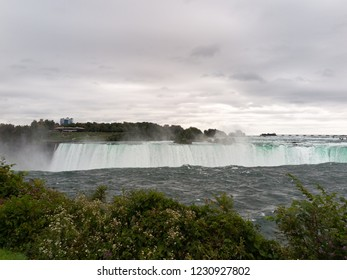 Niagara: Horseshoe Falls from above under cloudy sky