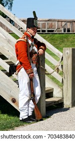 Niagara on the Lake – August 13, 2017: Enactment of Colonial British soldier resting in the Fort George National Historic Site. Fort George was the headquarters of the British Army in 1812