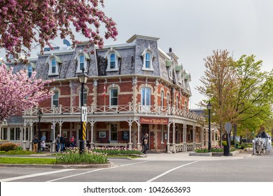 NIAGARA ON THE LAKE, CANADA - May 14, 2017: Prince of Wales hotel on Picton street of Niagara-on-the-Lake in spring. Built in 1864, Prince of Wales Hotel is a historic Victorian hotel.