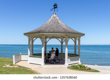Niagara on the Lake, Ontario, Canada, June 14, 2018: White gazebo along  Niagara River during summer, in Queen's Royal Park, where tourists pause for a rest.