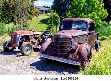 Niagara on the lake, Ontario - June 14, 2018: Old International Pickup Truck at  the lake shore of Niagara, rusted and abandoned.