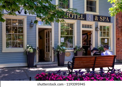 Niagara on the lake, Ontario - June 14, 2018: The colorful shops and restaurants in the main street of the city are one of the attraction to the tourists that visit the region.