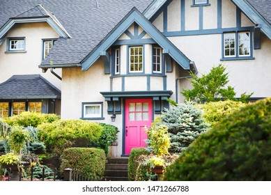 NIAGARA ON THE LAKE,CANADA - AUGUST 3, 2019: Beautiful house with colorful garden at summer time in Niagara on the Lake, Ontario, Canada