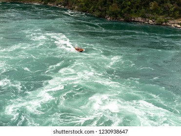 Niagara River Rapids in Gorge between Canada and United States with boat