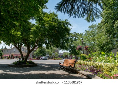Niagara-on-the-Lake, Ontario, Canada - July 5, 2018:  Simcoe Park in the summer, looking west to intersection of Queen and King Streets.
