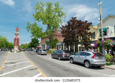 Niagara-on-the-Lake, Ontario, Canada - July 5, 2018:  Queen Street looking northwest at Memorial Clock Tower on left, shops on right.