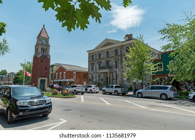 Niagara-on-the-Lake, Ontario, Canada - July 5, 2018:  Looking south across Queen Street at Memorial Clock Tower on left, shops and old Court House and City Hall at middle right.
