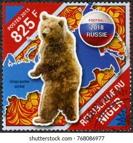 NIAMEY, NIGER - DECEMBER 28, 2015: A stamp printed in Niger shows bear, 2018 Football World Cup Russia, 2015