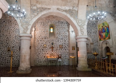 Nic, Qabala region, Azerbaijan - April 28, 2019. Interior view of Chotari church in Nic village of Qabala region in Azerbaijan. View with columns, lamps, religious paintings and candles.