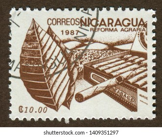 NICARAGUA - CIRCA 1987: a stamp printed in Nicaragua shows Agrarian Reform, Tobacco and cigarette illustration.