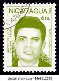 "NICARAGUA - CIRCA 1988: A stamp printed in Nicaragua from the ""Revolutionaries"" issue shows Silvio Mayorga Delgado, circa 1988."