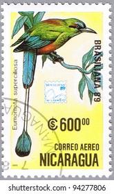 NICARAGUA - CIRCA 1989: A stamp printed in Nicaragua shows Eumomota superciliosa or Turquoise-browed Motmot or Torogoz, series, circa 1989