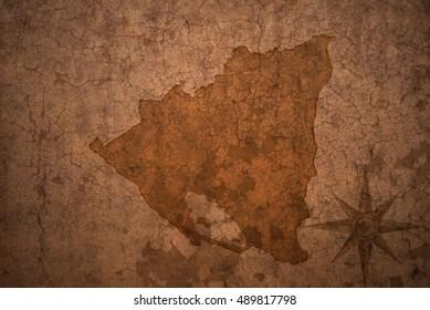 nicaragua map on a old vintage crack paper background