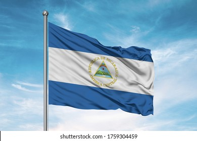 Nicaragua national flag cloth fabric waving on beautiful sky.