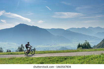 nice, active senior woman underway with her electric mountain bike in the Allgaeu Alps near Oberstdorf, Bavarian Alps, Germany