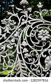 Nice ancient iron fence with floral decor. St. Petersburg, Russia