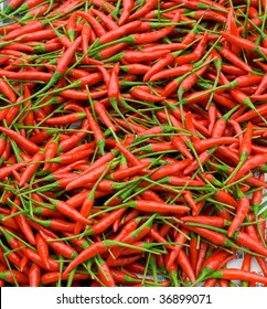 Nice background with fresh red hot pepper