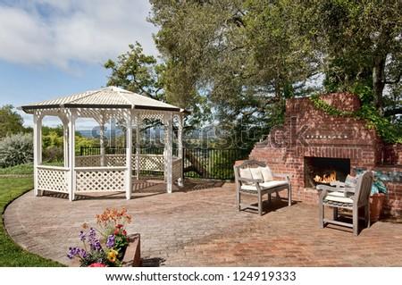 Nice Backyard Patio With Gazebo And Big Brick Fireplace