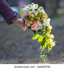 Nice and beautiful bouquet in the bride hand
