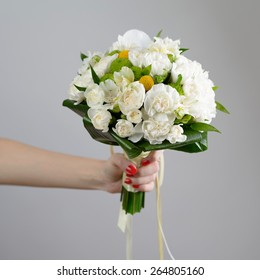 Nice and beautiful bridge bouquet in the hand