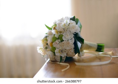 Nice and beautiful bridge bouquet  on the table