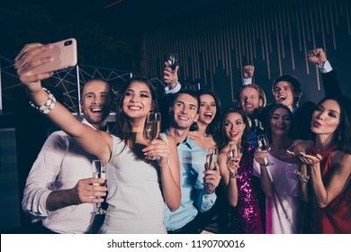 Nice beautiful charming graceful elegant cheerful glad positive gatherin ladies and trendy handsome funny gentlemen, having rejoice, taking self-portrait, chill out at fasionable night club