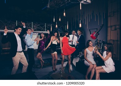 Nice beautiful charming graceful vogue exquisite elegant slim cheerful ladies and trendy funny funky gentlemen in formal-wear, corporate company event, chill out at fasionable night club