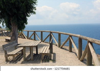 a nice bench. perfect for sitting above the sea