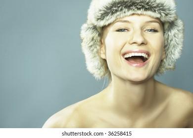 Nice blond Woman Wearing Fur Hat