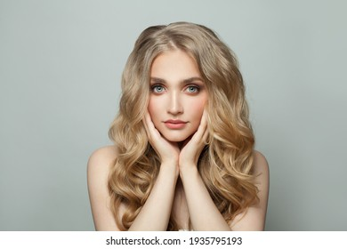 Nice blonde woman with long perfect hair on white background