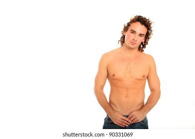 nice body guy with long hair posing on a studio