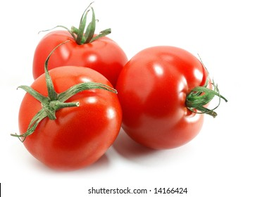 Nice bright tomatoes isolated on white