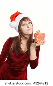 The nice brunette with a Christmas gift in hands