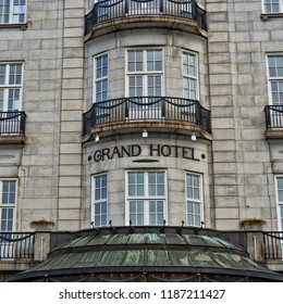 Nice building of Grand Hotel in Oslo. Classic style. Architecture of Scandinavian countries. Norwegian lifestyle. Close up. Norway, Oslo – November 4, 2017