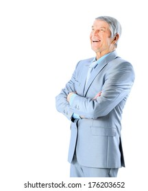 Nice businessman at the age of laughs. Isolated on a white background.