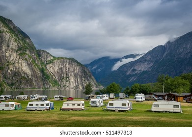 Nice camping at the fjord of Norway with beautiful mountain background. Eidfjord, Hordaland, Norway