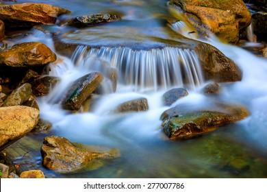Nice cascade of mountain waterfall
