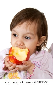 Nice Caucasian daughter with an apple on a light background