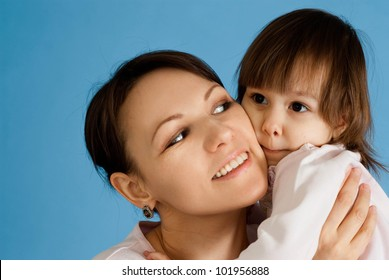 Nice Caucasian lady with a daughter on a blue background