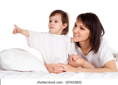 A nice Caucasian mother with her daughter on the bed