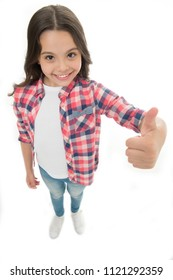 Nice choice. Highly recommend. Kid girl shows thumb up gesture, isolated white background. Girl happy smiling recommendation. Child highly recommend with thumb up gesture. Make right choice.