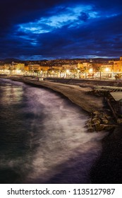 Nice city skyline in France, sea and beach in the evening
