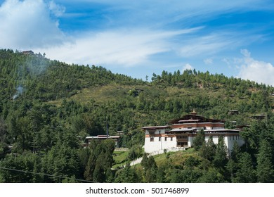 nice cloud over Dzong and village Countryside of Paro valley in bhutan