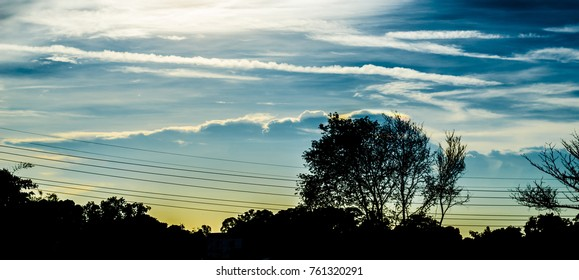 Nice clouds in sky with tree silhouette