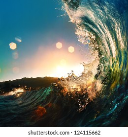 nice colored ocean wave falling down at sunset time